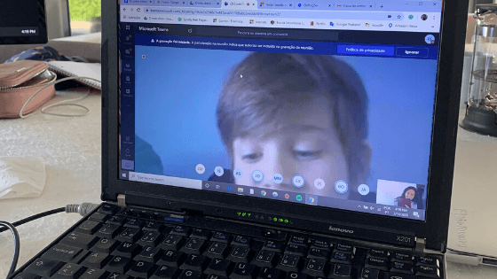 Laptop showing Microsoft Teams call with student